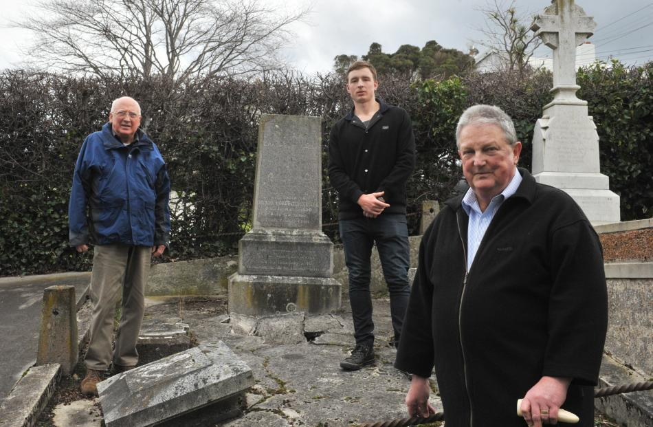 Helping to improve the damaged grave of early Dunedin surveyor Charles Kettle are (from left)...