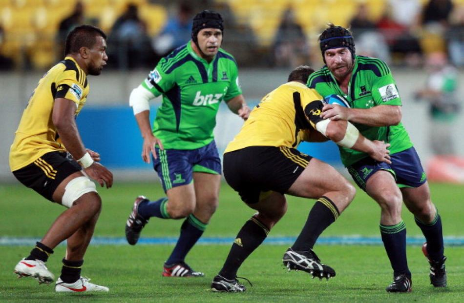 Highlanders hooker Andrew Hore tries to evade a tackle during the round four Super 15 match...