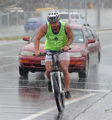 Highlanders players take part in a triathlon from Forsyth Barr Stadium to the St Clair Salt Water...