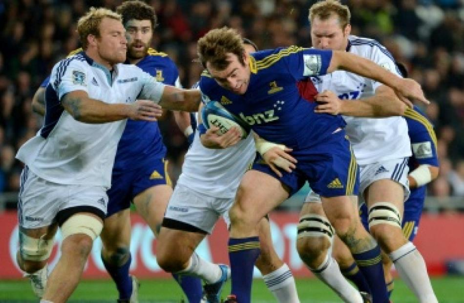 Highlanders skipper Andrew Hore charges forward during the Blues game on Saturday. Photo by...