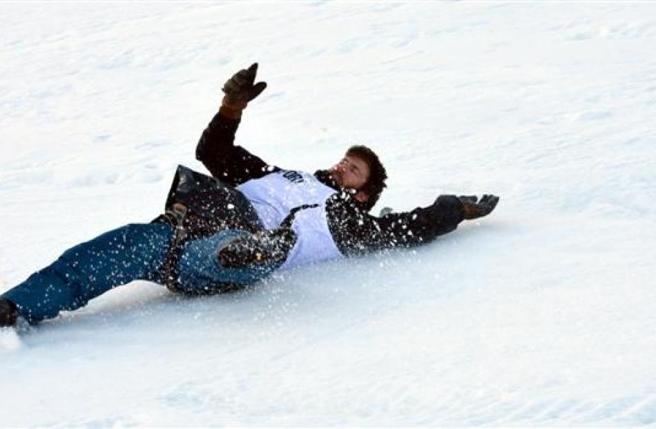 Hilton Scott,  of Frankton,  slides down the frozen course at the Queenstown Winter Festival dog...