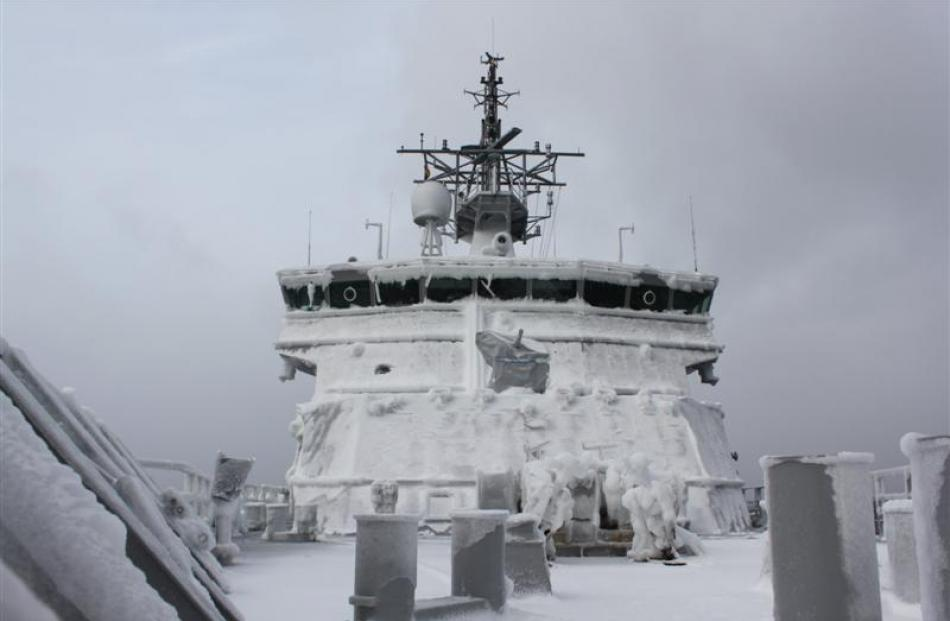 HMNZS Wellington is encrusted with ice while on manoeuvres in the Ross Sea in 2011.