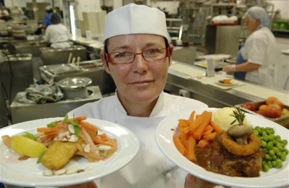 Otago District Health Board executive chef Sarah Marshall displays two meals from the new menu at...