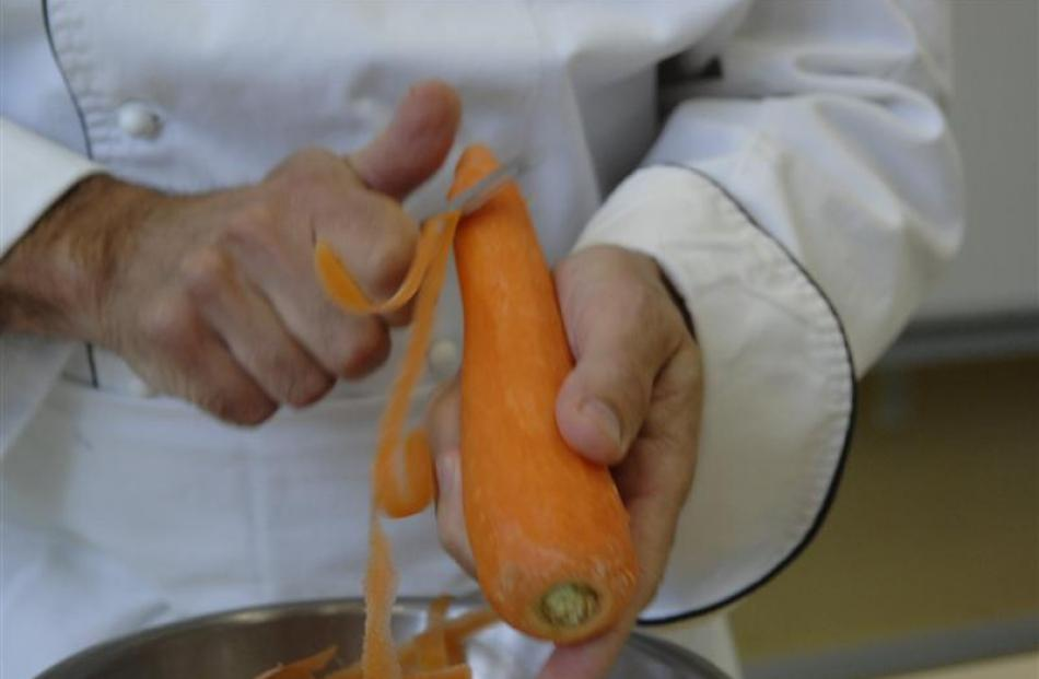 1. Peel the vegetable. It's easiest to peel a carrot before topping and tailing it. Photos by...