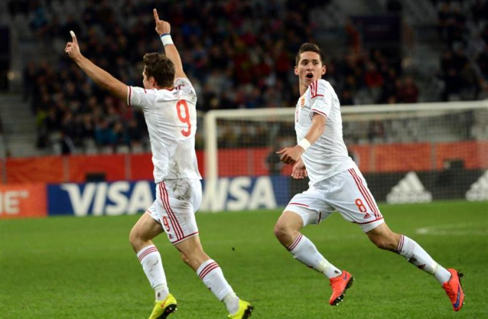 Hungary football players Bence Mervo (left) and Mate Vida celebrate a goal. Photo by Peter McIntosh.