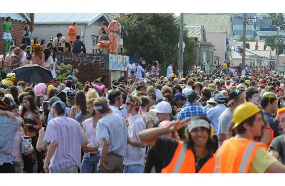 Partygoers fill the street. Photo by Peter McIntosh.