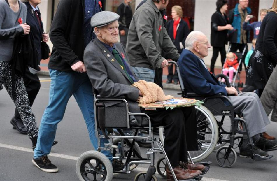 In the Mosgiel parade in Gordon Rd are (from left) Alan Anderson (92), of Wanaka, and Gerald...