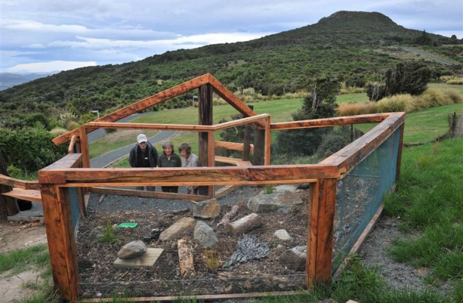 Inspecting  the new tuatara viewing pen are (from left) Orokonui Ecosanctuary volunteer Brendan...