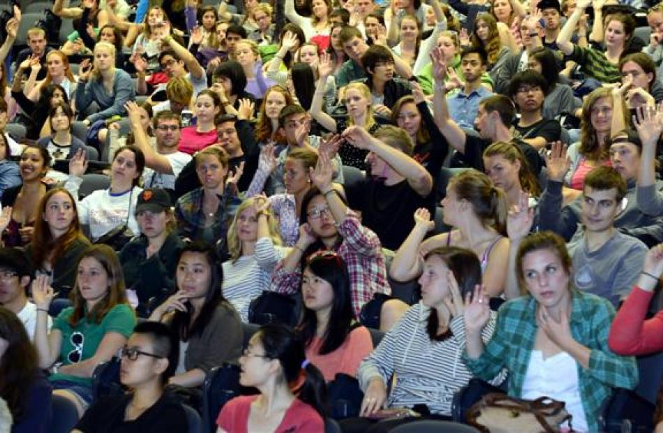 International students sit through a lecture welcoming them to the University of Otago yesterday.
