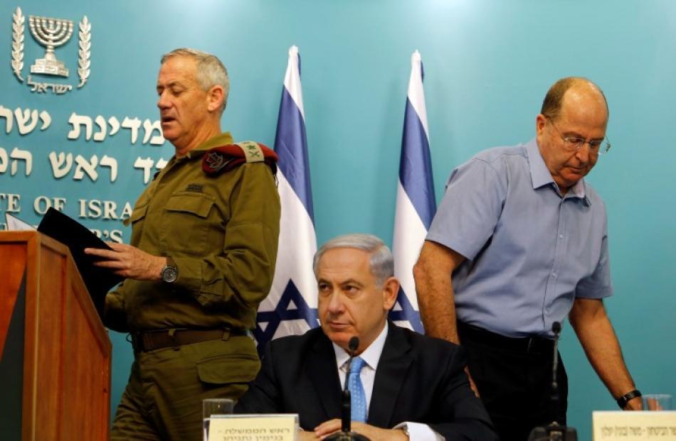 Israel's Prime Minister Benjamin Netanyahu (C), Israeli military chief Lieutenant-General Benny...