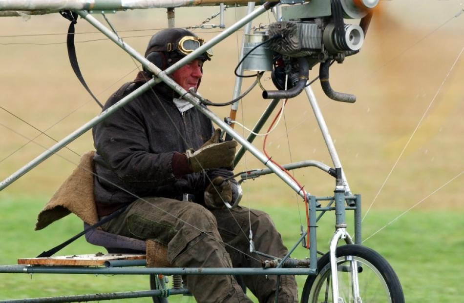 Jack Mehlhopt at the controls of a bamboo and bicycle tubing aeroplane in 2003. Photo by Getty