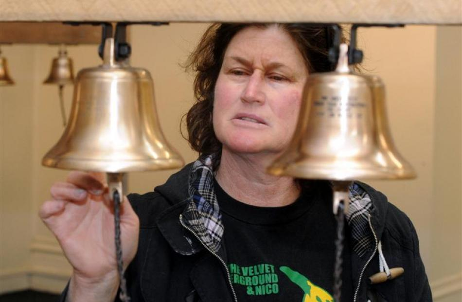 Jai Hall with her bells that are bound for woolsheds around the country to honour the...