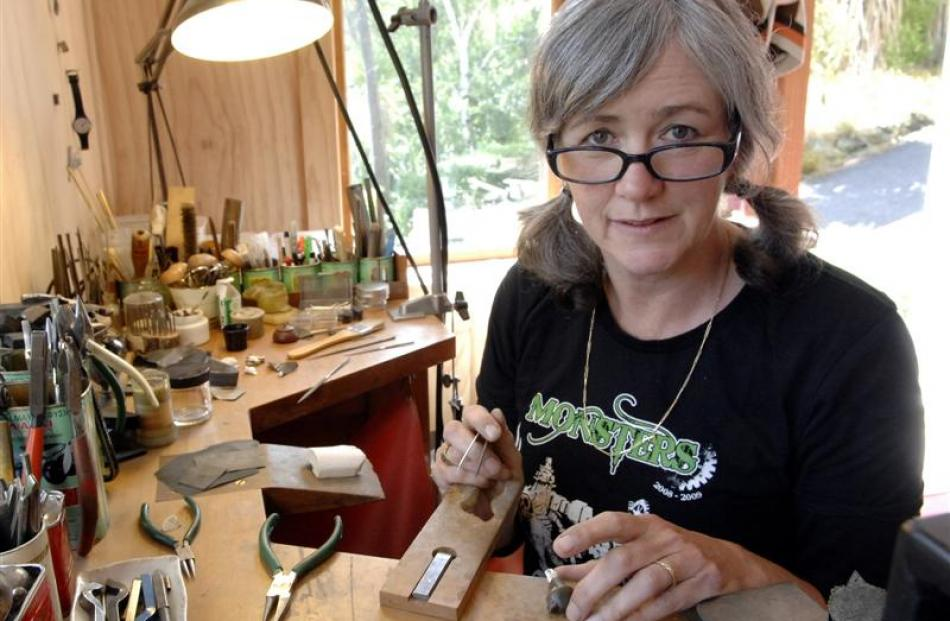 "Jeweller Jane Dodd works on new pieces for her upcoming exhibition, ""Blood Sports"", in her..."