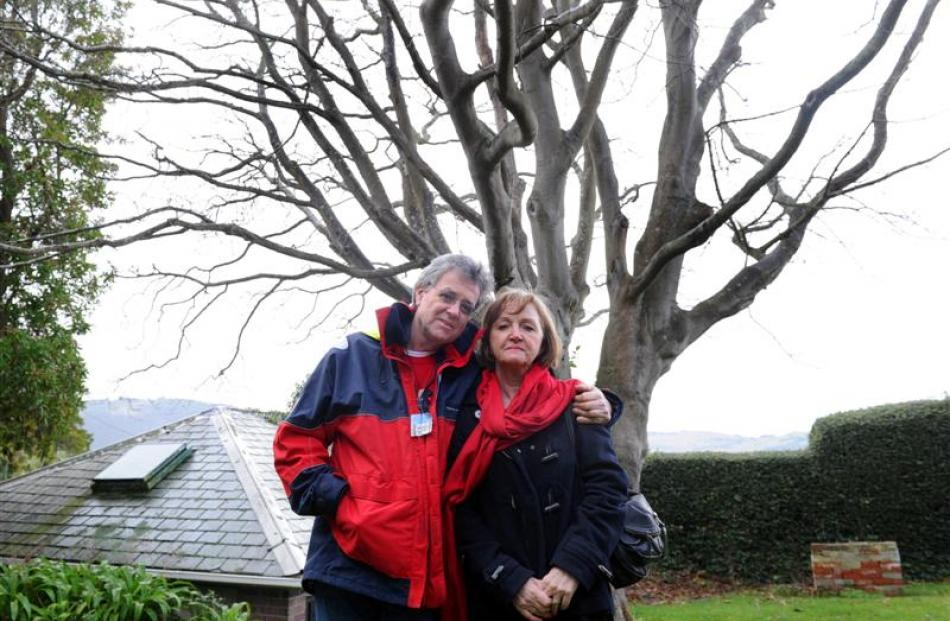 John and Eve Jackson in front of the protected tree they want to remove from their Heriot Row...