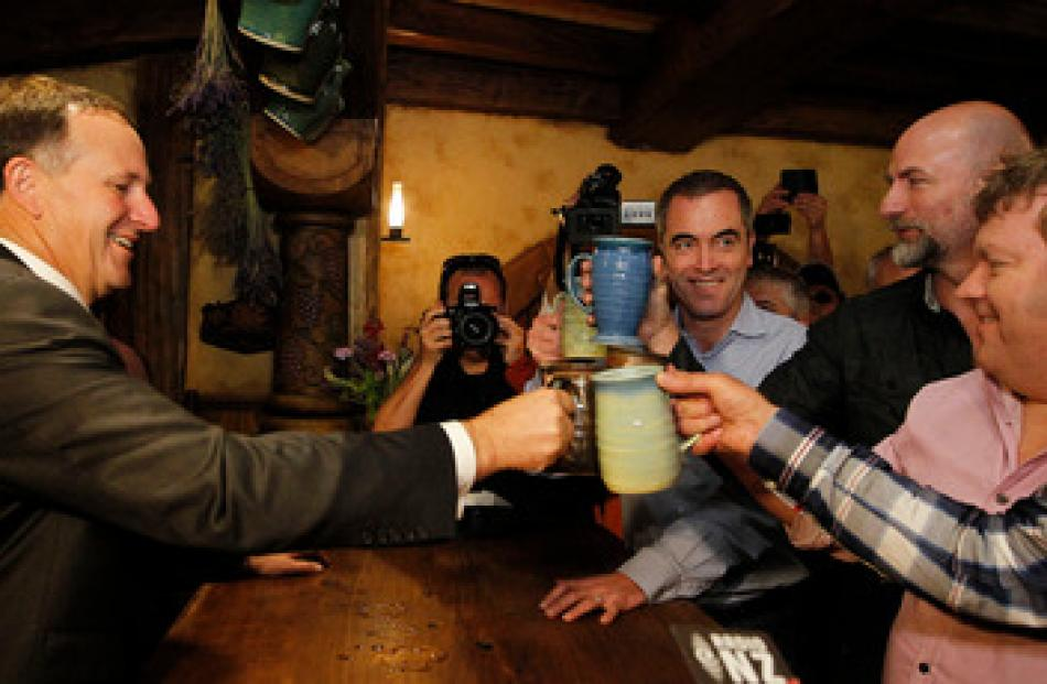 John Key, accused of having a 'taste for celebrity', shared a beer with actors from The Hobbit...
