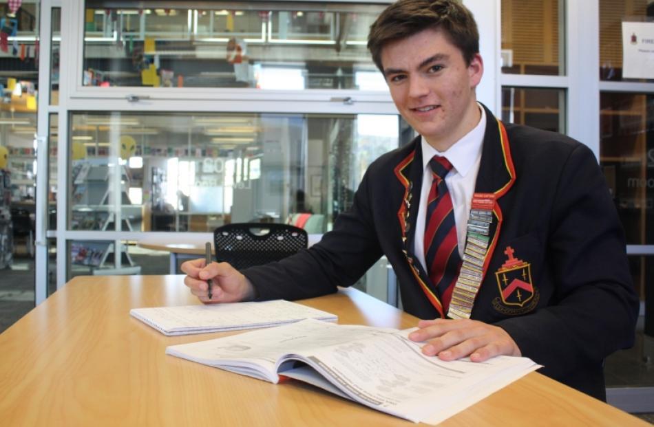 John McGlashan College pupil Ed Davies (17) brushes up on  biology  before his Cambridge...