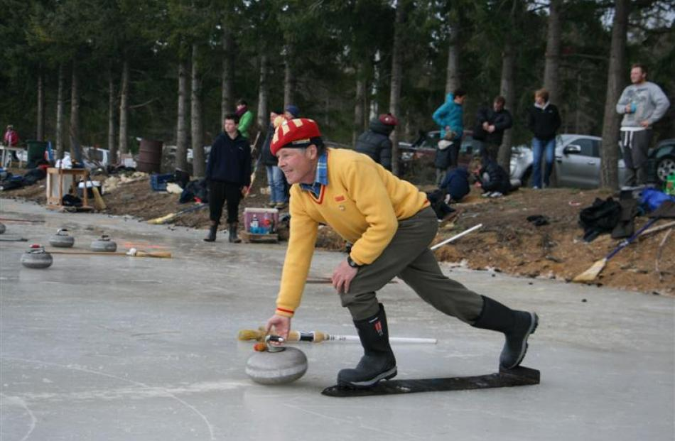John Mulholland, of the Oturehua club, the moment before he delivers the stone across the rink....