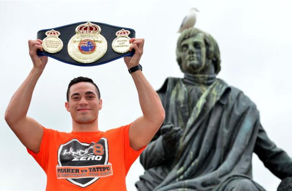 Joseph Parker shows off his heavyweight championship belt in the Octagon. Photo by Peter McIntosh.