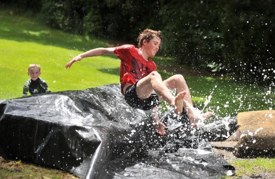 Josh Rosie (15) makes a splash, watched by William Helm (7).