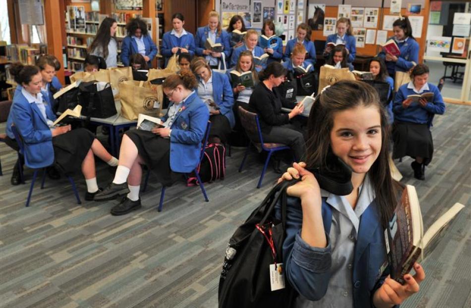 Judah Kelly (13), of Queen's High School in Dunedin,  breaks out  her summer book bag with...