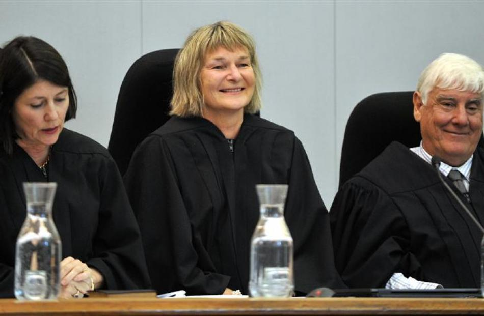 Judge Bernadette Farnan is flanked by  Chief District Court Judge J-M Doogue and Principal Family...