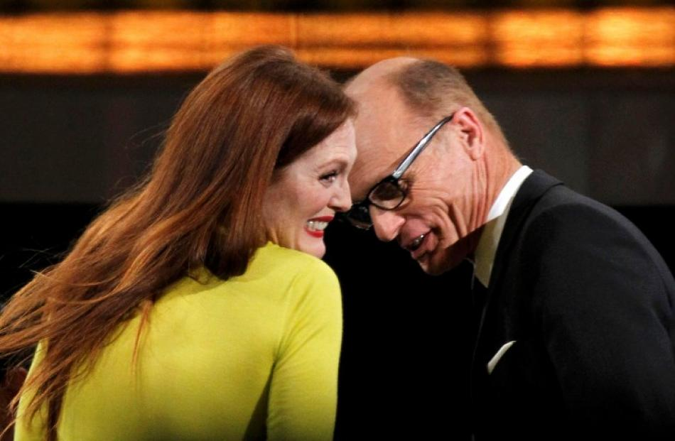 Julianne Moore reacts with co-star Ed Harris after winning the award for outstanding lead actress...