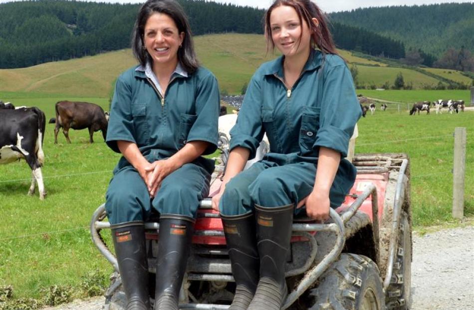 Kara-Lee Clark (left) and Ashleigh McKechnie make up an all-female crew on a dairy farm near...
