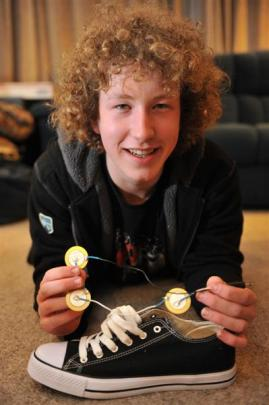 Karl Brinsdon will use a $2000 scholarship to fund his walking-powered cellphone charger concept,...