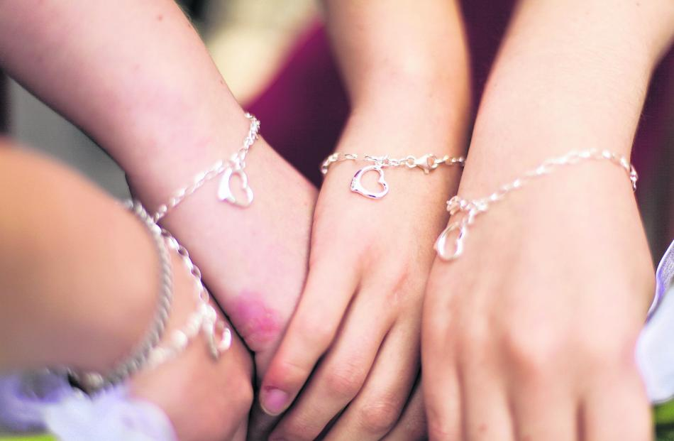 Kate Anderson's attendants show off their bracelets. Kate married Mathew Anderson in January....