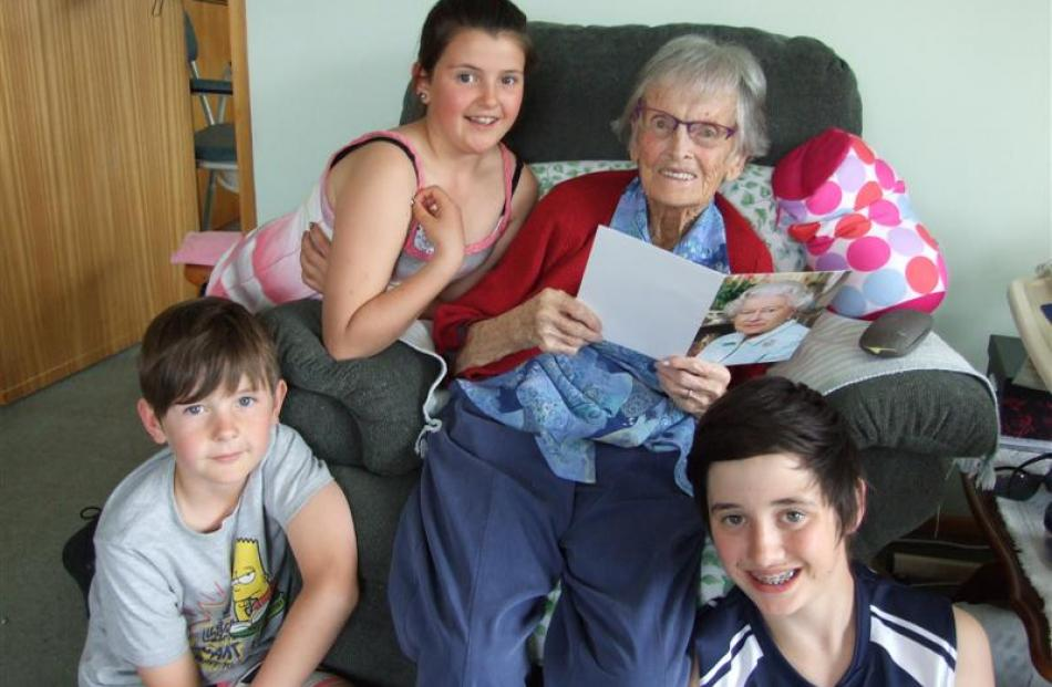 Kath Kennedy, of Alexandra, who turns 100 today,  shows her birthday card from the Queen  to her...