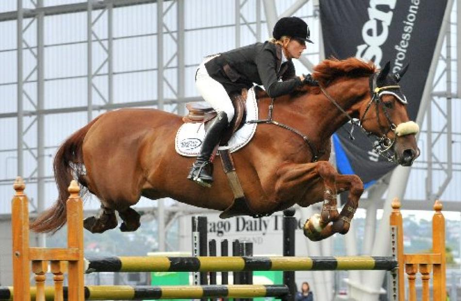 Katie McVean, on Dunstan Kiwi Iron Mark, wins the Super Grand Prix show jumping at Ride the...