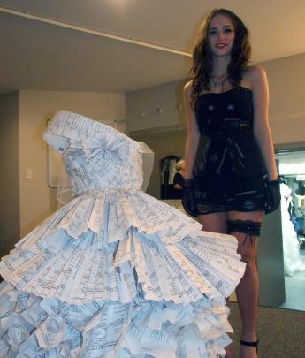 Katie Scott with her winning dress made of copies of her parents' marriage - and divorce -...