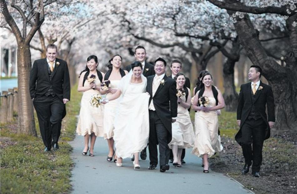 Keagan Ho and Michelle Soakell with their wedding party after their marriage in Christchurch last...