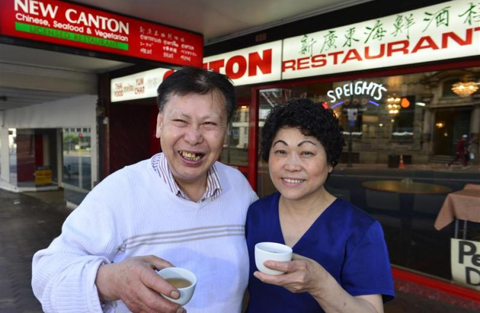 Kee and Sanny Young toast the end of an era at the New Canton Restaurant yesterday. Photo by...