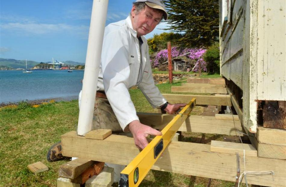 Keith Lewis works on the Lewis cottage at Deborah Bay. Photos by Gerard O'Brien.