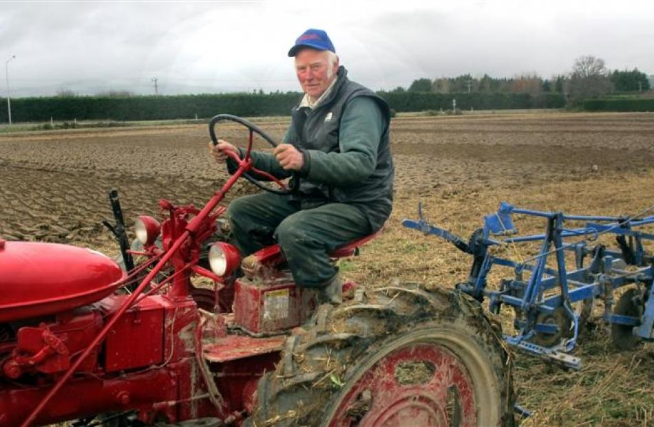 Keith Macaulay on a 1951 Farmall McCormick tractor with a Reid and Gray trailing vintage plough.