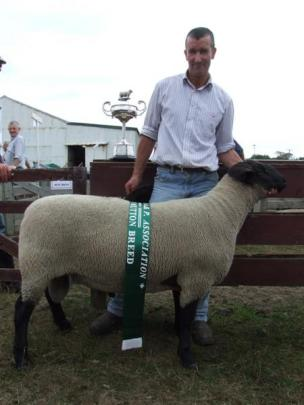 Kerry Dwyer and his champion Suffolk ram. Photos by Sally Rae.