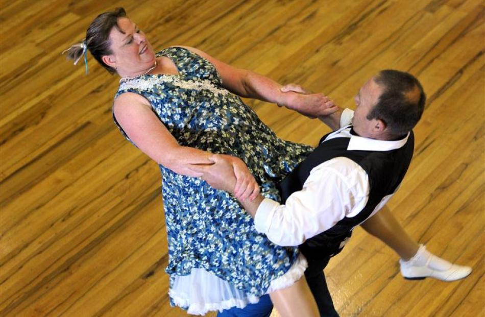 Kevin and Derelle Polaschek, of Christchurch, flaunt their moves in the senior masters final of...