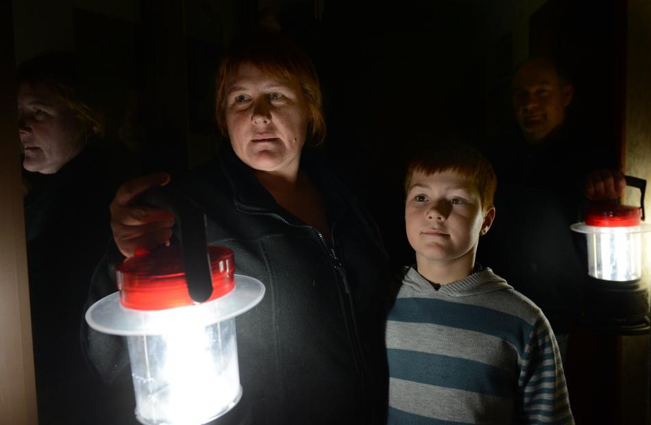 Kinmont Cres residents Michelle Bone, son Tyson and husband Paul were among those hunkering down...