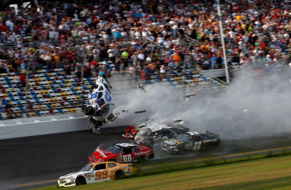 Kyle Larson (32) and his Chevrolet end up in the fence during the final lap crash at the NASCAR...
