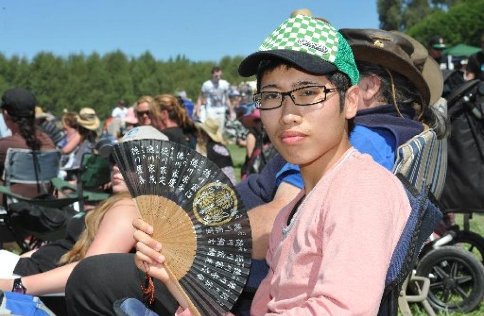 Kyohei Takehisa, of Japan, keeps cool while watching the Outram Rodeo yesterday.
