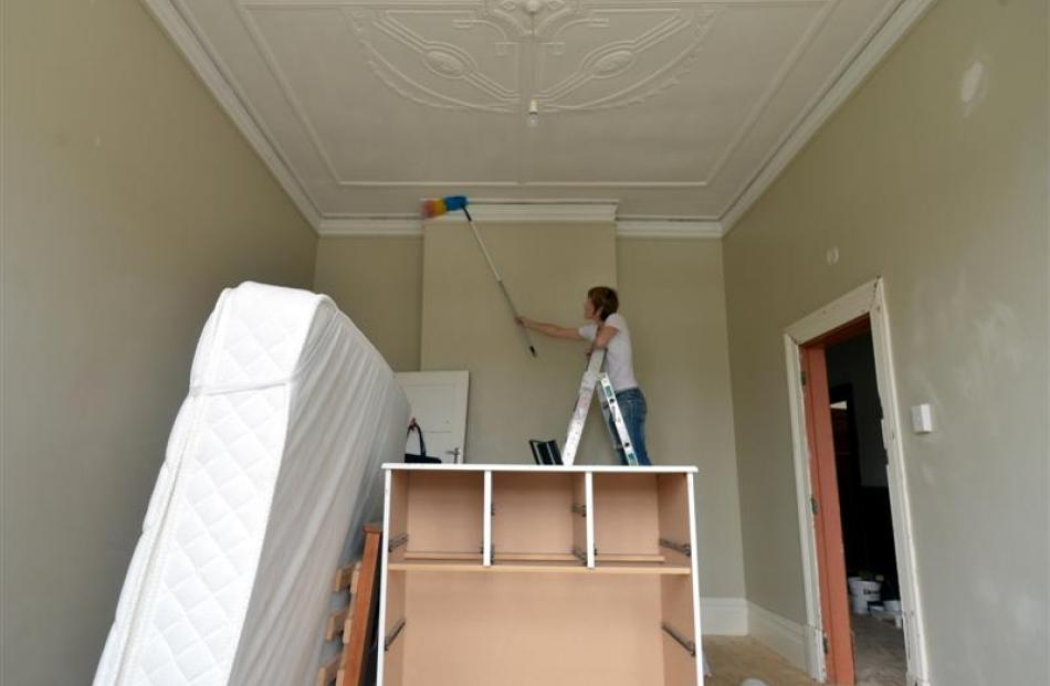 Landlady Fiona Partridge does some dusting in preparation for painting this week.