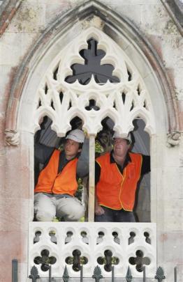 Stonemasons Marcus Wainwright and Craig Morton check the fit of part of an Oamaru stone window