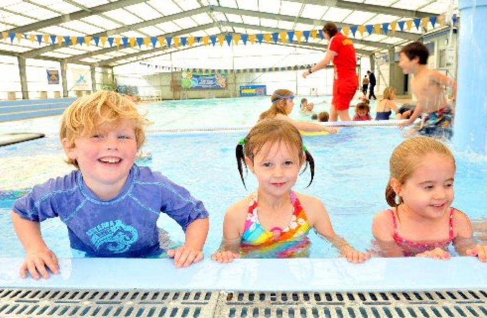 Concord School pupils (from left) Quinn Owen, Ariah Berryman and Savannah Erey (all 5) have fun...