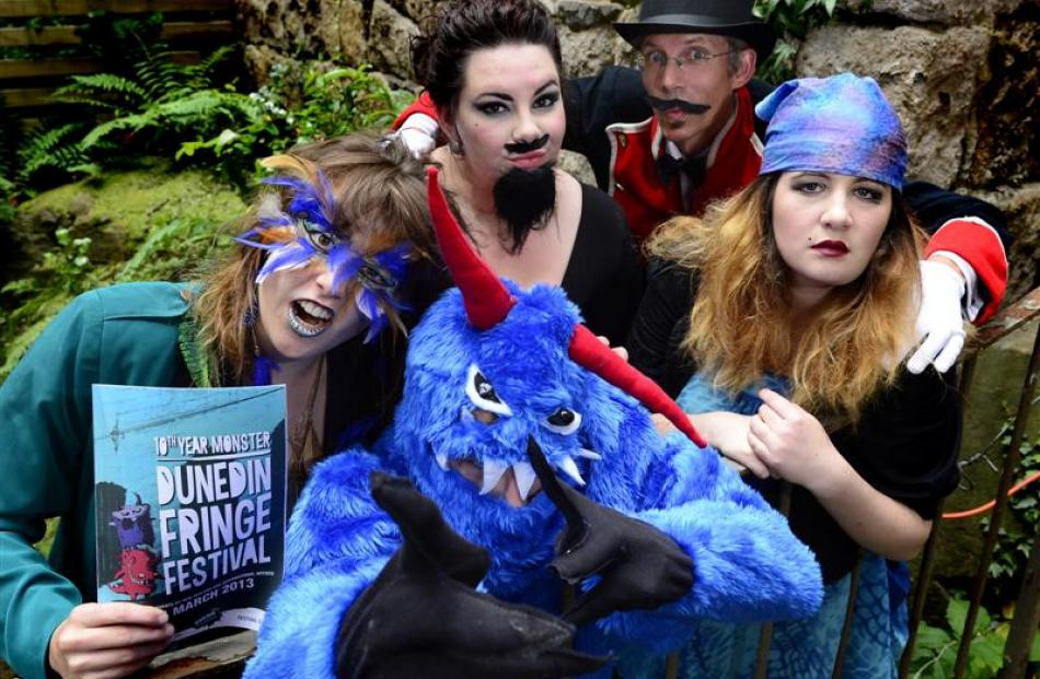 Launching the 2013 Fringe Festival programme in a Dowling St alleyway last night are (from left)...