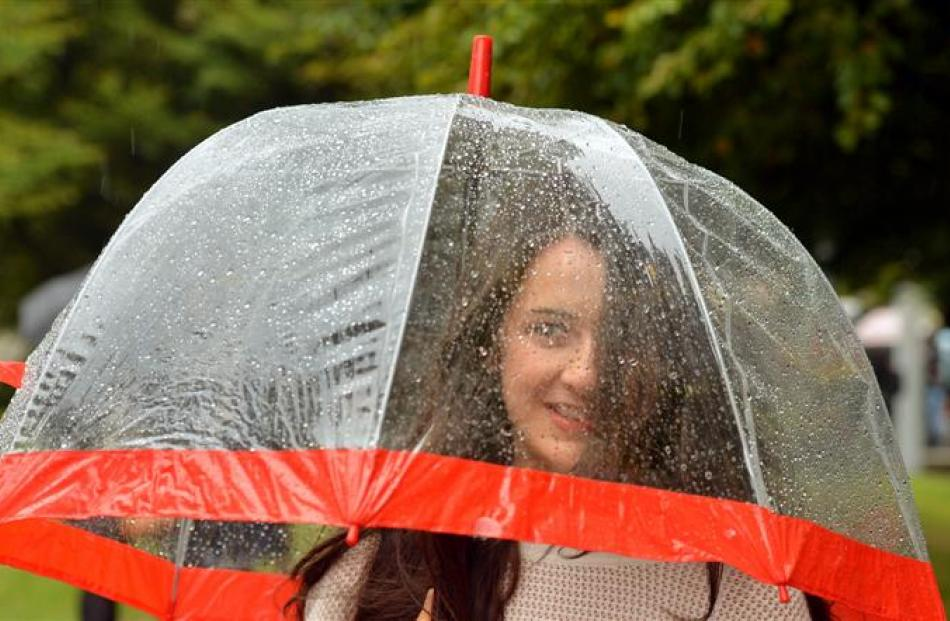 Law and accounting student Deborah Magee (above left), of Christchurch, is ready for the wet...