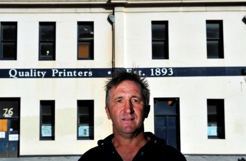 Lawrie Forbes outside the former McIndoe Print building in Vogel St, which he wants to transform...