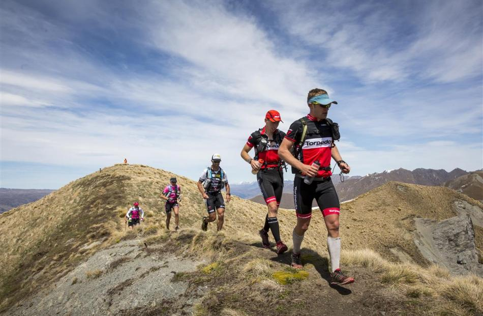 Leading a pack of athletes on the final stage of Red Bull Defiance in 2014 is Queenstown-based...