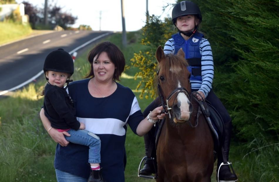 Leah Wilson and daughters Emma (3) and Katie (8), on pony  Pluto, walk in  Dalziel Rd, Dunedin,...