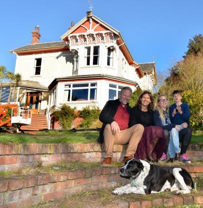 Lee Vandervis (left), Antonie, Juliette and Lukas in the garden of their Garfield Ave property....